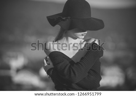 Beauty and fashion. beauty of pretty young woman in black hat #1266951799