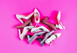 Beauty and fashion concept. Fashionable women shoes isolated on pink background. View from above. Shoe for women. Stylish classic women leather shoe. High heel women shoes on red background.