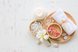 Beauty and fashion concept with spa set on white rustic wooden background