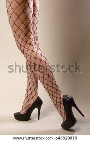 Sexy legs in fishnet pantyhose pics