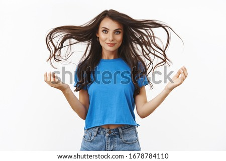 Beauty and freedom. Self-assured good-looking sassy brunette woman showing her confidence, healthy beautiful hair float in air, haircare and hairdresser concept, white background