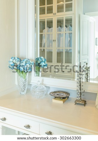 Beauty and make-up concept: mirror,jewelry and makeup set on a dressing table
