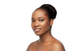 beauty and people concept - portrait of happy smiling young african american woman with bare shoulders over white background