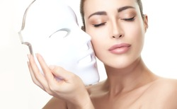 Beauty and skin care concept. Healthy skin model woman with led mask. Photon therapy light treatment skin rejuvenation led facial mask. led skin rejuvenation therapy. Isolated on white with copy space