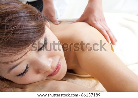 Beauty and Spa - Asian Girl having a massage on her back
