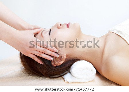 Beauty and Spa - Asian Girl having a massage on her head