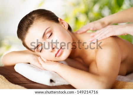 beauty and spa concept woman in spa salon getting massage