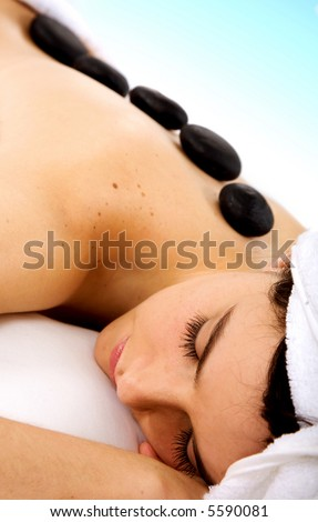 Beauty and Spa - Girl with zen stones on her back