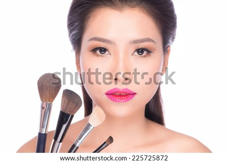 Beauty Asian Girl with Makeup Brushes. Natural Make-up for Asian Woman with Brown Eyes. Beautiful Face. Makeover. Perfect Skin. Applying Makeup #225725872