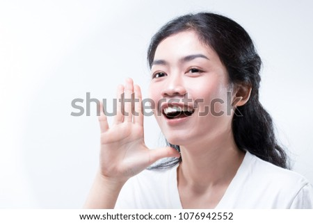 beauty asian woman long black curly hair with white shirt telling #1076942552