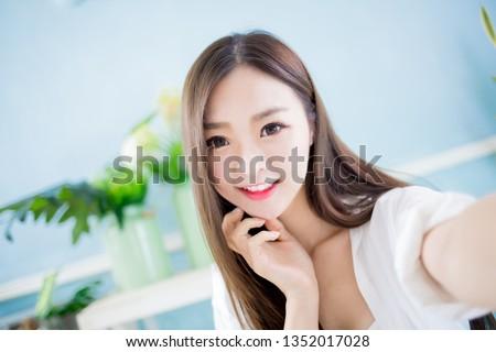 beauty asian woman take a selfie at home