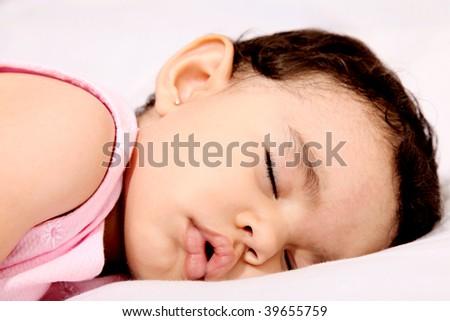 Beauty baby sleeping on white pillow. Serene scene