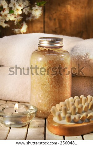 Beauty bath salts, candle and brush for bath