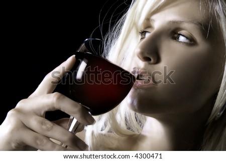 beauty blond girl is drinking wine