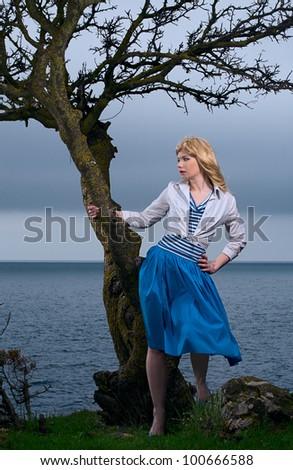 beauty blond woman stand on sea coast