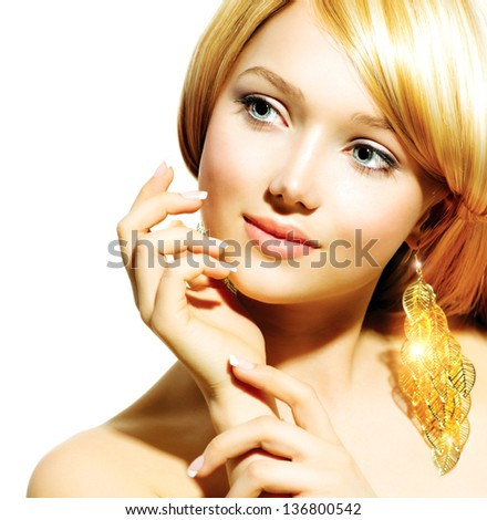 Beauty Blonde Fashion Model Girl With Golden Earrings Beautiful Hair and Nails Manicure and Skincare concept