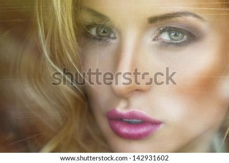 Beauty blonde woman behind window
