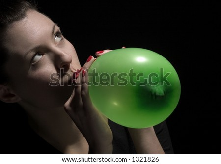 stock photo : beauty blower puff a green balloon