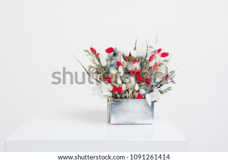 Stock Photo Beauty bouquet of dried flowers on a white