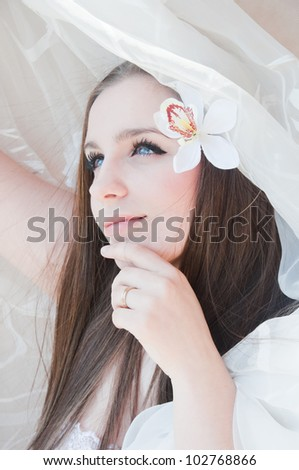 Beauty bride with orchid outdoor - stock photo