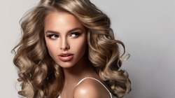 Beauty brunette girl with long  and   shiny wavy  hair .  Beautiful   woman model with curly hairstyle . Perm, trichology and care