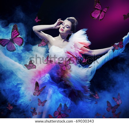Beauty brunette on the fog with butterflies