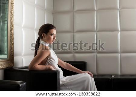 Beauty brunette woman on sofa in nightclub #130358822