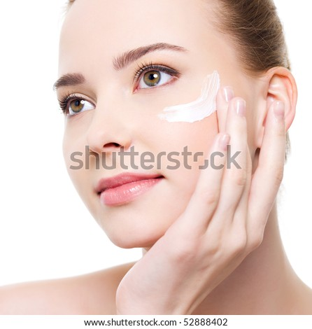 Beauty caucasian young woman applying cosmetic under eyes