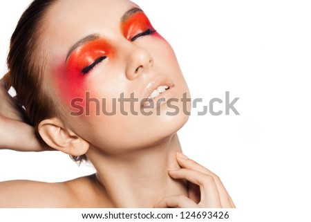 Beauty close-up female portrait .  Model face with magic creative fashion multicolored make-up. Perfect skin. Face painting, cosmetics, beauty and make up. White background.Space.Orandge eyeshadow.