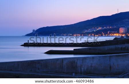 beauty coast city by evening - stock photo
