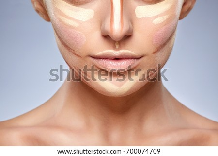 Beauty concept. Closeup of woman with contouring on face, base for make-up. Types of drawing make-up, half face without eyes of girl with nude make-up