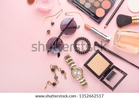 Beauty concept in a blog. Professional female make-up accessories, watch, bracelet, lipstick, powder, on a pink background. Women's background and fashion. Instagram, women's things. Flat lay