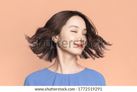 Beauty concept of a young asian woman. Hair care. Cosmetics. Stockfoto ©