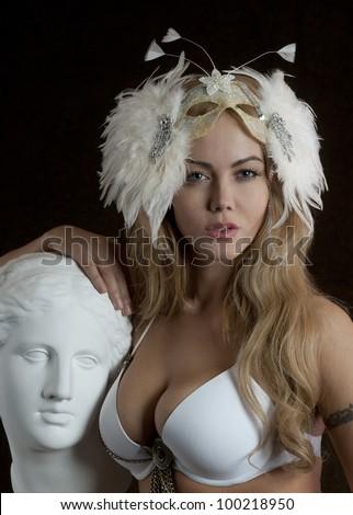 Beauty contest winner posing sexy with venera statue