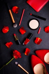 Beauty cosmetic black background. Makeup essentials. Shoes, red lipstick, powder, brushes set. Cosmetic products. Top view. Feminine or fashion background. Cosmetics. Beauty products. Modern woman