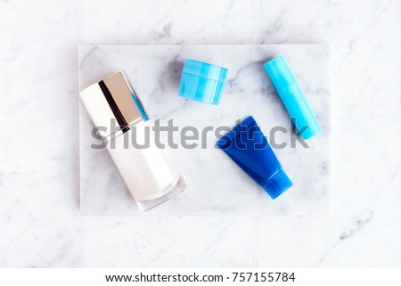 Beauty cosmetic products on white marble table #757155784