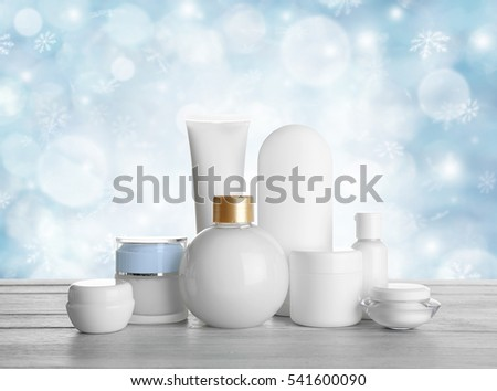 Beauty cosmetic set on table. Snowy effect. Holiday celebration concept. #541600090
