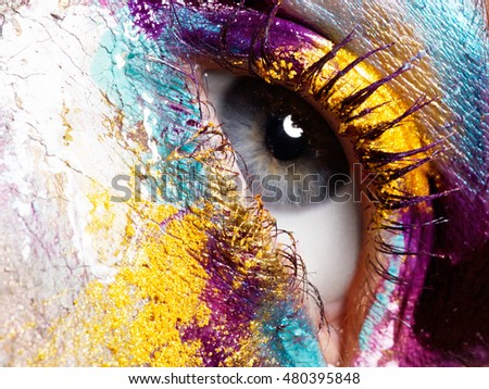Beauty, cosmetics and makeup. Magic eyes look with bright creative make-up. Macro shot of beautiful woman's face with perfect art make up. Body art - Shutterstock ID 480395848