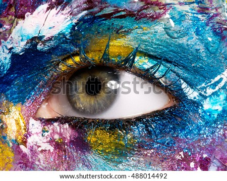 Beauty, cosmetics and makeup. Magic eyes look with bright creative make-up. Macro shot of beautiful woman's face with perfect art make up. Closeup of female eye. Body art - Shutterstock ID 488014492