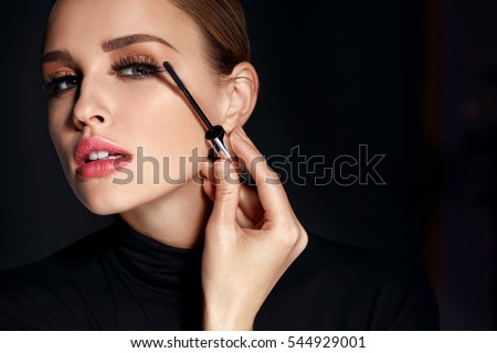 Beauty Cosmetics. Closeup Of Beautiful Sexy Woman Putting Black Mascara On Long Thick Eyelashes With Brush. Fashionable Female Model With Soft Skin, Perfect Makeup And Fake Eyelashes. High Resolution #544929001