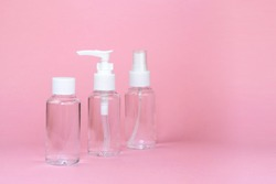 Beauty cosmetics glassbottle; branding mock up; front view on pastel pink background. Package for essential oil.