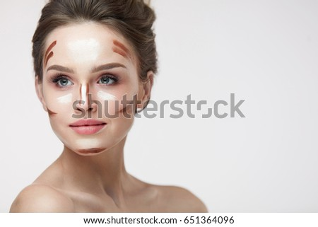 Beauty Cosmetics. Portrait Of Beautiful Sexy Female With Contouring And Highlighting Lines On Facial Skin. Closeup Of Attractive Young Woman With Fresh Natural Makeup Contour Lines. High Resolution #651364096