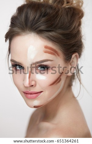 Beauty Cosmetics. Portrait Of Beautiful Sexy Female With Contouring And Highlighting Lines On Facial Skin. Closeup Of Attractive Young Woman With Fresh Natural Makeup Contour Lines. High Resolution
