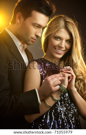 Beauty couple holding engagement ring