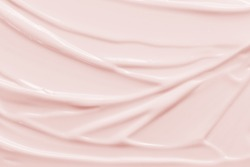 Beauty cream texture background. Pink color face cream lotion moisturizer smear. Skincare cosmetic  product  strokes