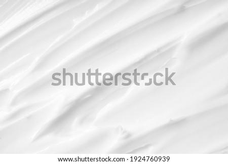 Beauty Cream Texture. White lotion, moisturizer, skin care cosmetics application background. Foto d'archivio ©