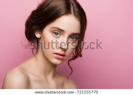 Stock Photo Beauty cute fashion model with natural make up on pink background