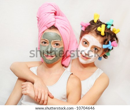 Beauty day of twin sisters, one with a towel on her head, other with hair rollers, both wearing face masks. Please check for more.