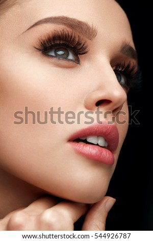Beauty Face. Beautiful Sexy Woman With Healthy Fresh Soft Toned Skin And Perfect Facial Makeup. Closeup Of Young Female Model With Long Black Thick Fake Eyelashes, False Eye Lashes. High Resolution #544926787