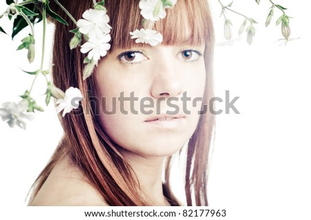 Beauty face of the young beautiful woman with flowers